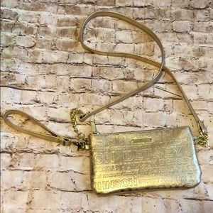 Betsey Johnson gold wristlet with phone charger